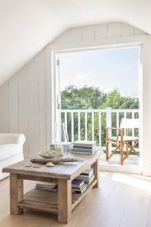 Home showcase a-frame attic open to sunny summer patio - CAIF25078