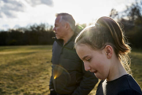 Portrait of girl with her father on a meadow - AUF00282