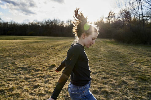 Happy girl dancing on a meadow - AUF00285