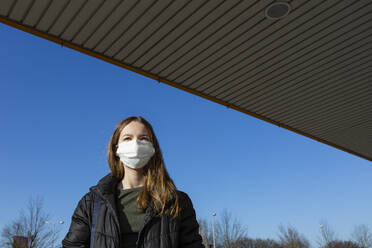Portrait of girl wearing mask outdoors - OJF00378