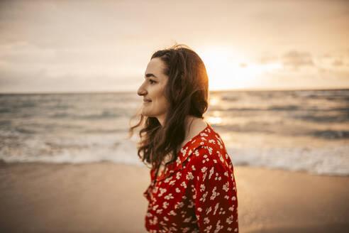Woman at the seafront at sunrise, Miami, Florida, USA - DAWF01290