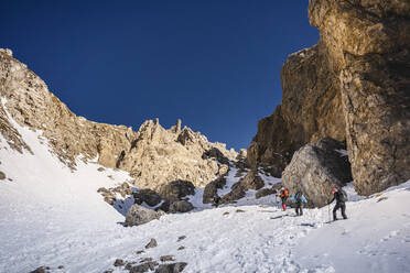 Group of mountaineers climbing a gully, Orobie Alps, Lecco, Italy - MCVF00269