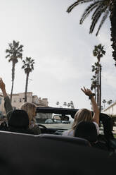 Back view of two young women in a convertible, Newport Beach, USA - LHPF01213