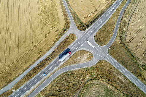 Germany, Bavaria, Drone view of road intersection between countryside fields in summer - RUEF02713