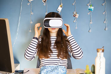 Portrait of girl at home using Virtual Reality Glasses - LVF08749
