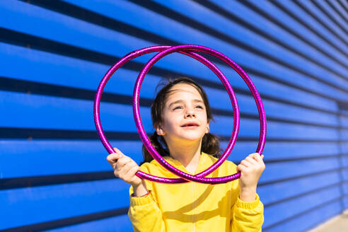 Portrait of little girl with gymnastic rings looking up - ERRF03254