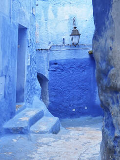 Morocco, Chefchaouen Province, Chefchaouen, Empty alley between old blue-colored houses - VEGF01869