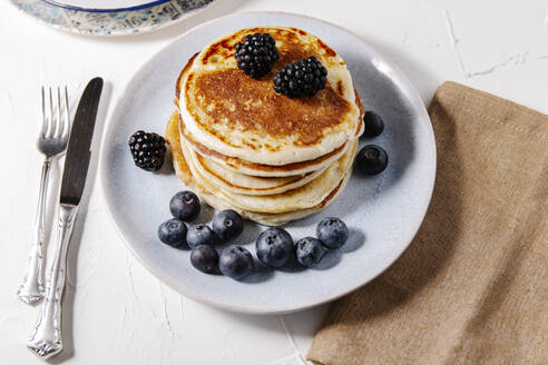 Stack of homemade pancakes on a plate - CAVF78554