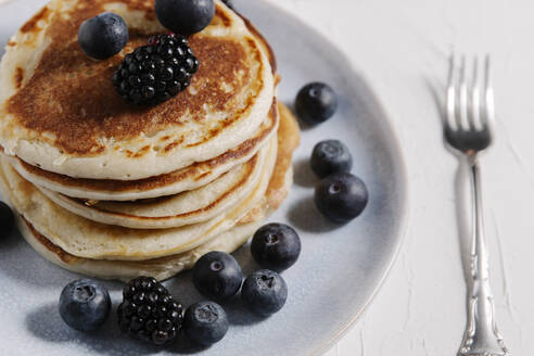 Stack of pancakes with berries on top - CAVF78557
