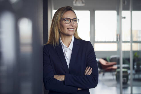 Portrait of smiling businesswoman in office - RBF07506