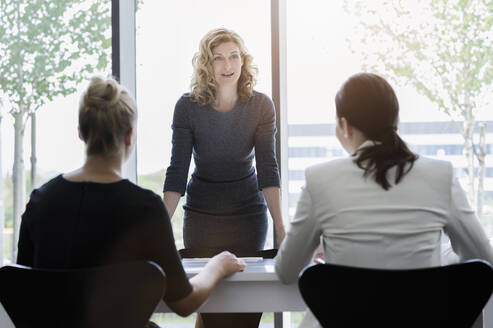 Businesswomen having a meeting in bright office - BMOF00394
