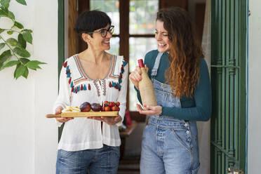 Happy women serving Mediterranean lunch - VSMF00144