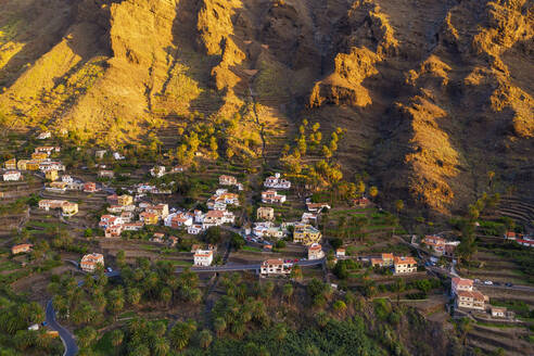 Spain, Santa CruzdeTenerife,ValleGran Rey, Aerial view of village houses on LaGomeraat dusk - SIEF09749