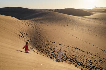 Mother and daughter playing in sand dunes, Gran Canaria, Spain - DIGF09628