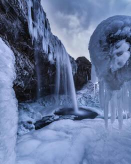Iceland, Long exposure of Seljalandsfoss in winter - TOVF00152