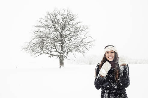 Portrait of happy young woman in winter landscape - WFF00308