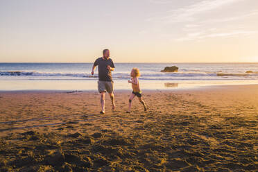 Father and son playing and running on the beach - IHF00326