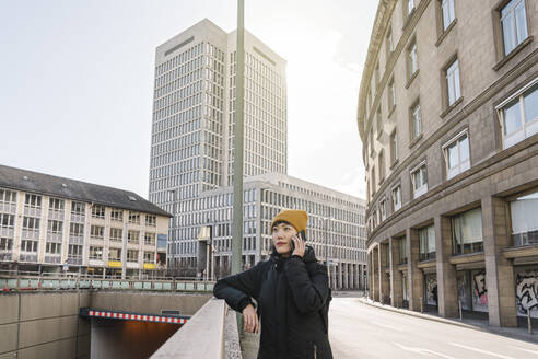 Woman on the phone in the city, Frankfurt, Germany - AHSF02218