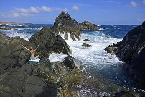 Woman standing at natural pool, Arikok National Park, Aruba, Antilles - ECPF00885