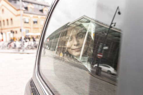 Woman in the rear of a taxi looking out of the window, London, UK - WPEF02796