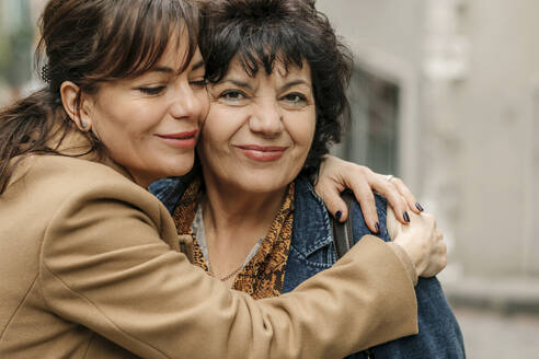 Portrait of happy woman hugging her mother - OGF00278