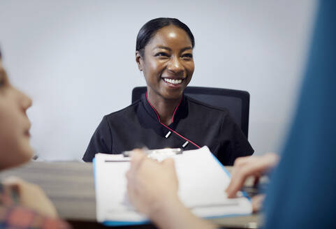 Portrait of smiling receptionist in a dental practice - PWF00036
