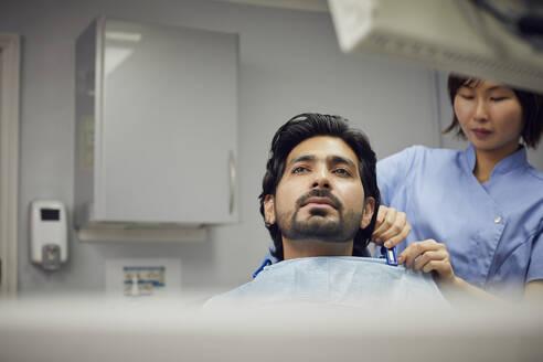 Medical secretary preparing dental treatment for patient - PWF00045