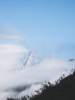 Spain, Cantabria, Clouds shrouding snowcapped peak in Picos de Europa - FVSF00141