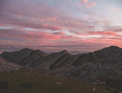 Spain, Cantabria, PicosdeEuropa range at pink moody dawn - FVSF00150
