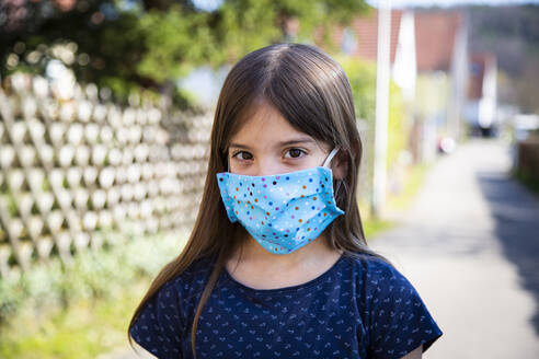 Girl wearing homemade protective mask - LVF08829