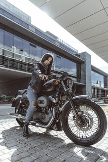 Portrait of confident young woman on motorcycle - DAMF00372