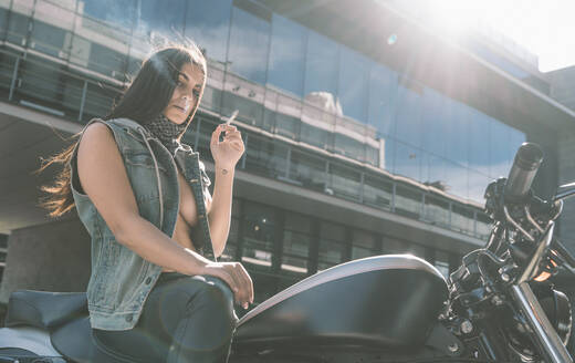 Portrait of sexy young woman on motorcycle - DAMF00375