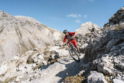 Man riding on mountainbike, Munestertal Valley, Grisons, Switzerland - HBIF00108