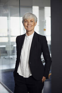 Portrait of content senior businesswoman in an office - RBF07589