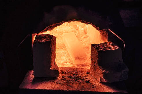Steel for a knife in melting furnace in a smithy - WFF00354