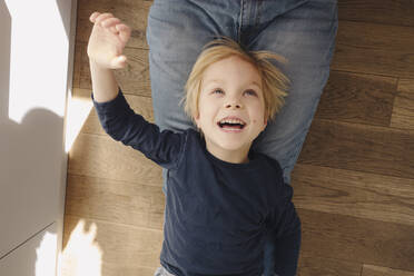 Portrait of happy little boy playing with his father at home - JOSEF00339