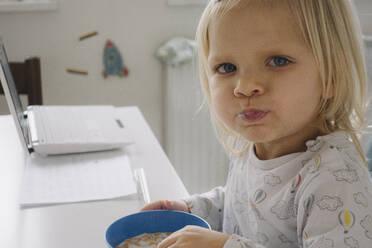 Portrait of toddler girl having breakfast - JOSEF00342