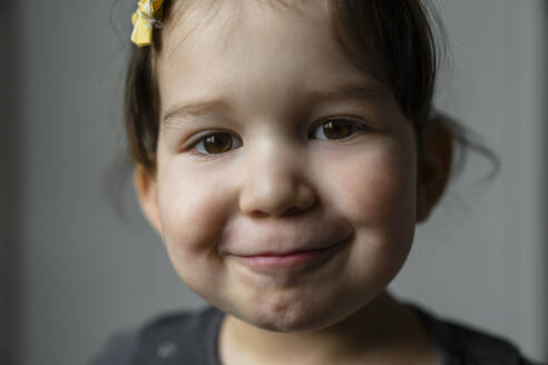 Portrait of smiling little girl with brown eyes - MGIF00898