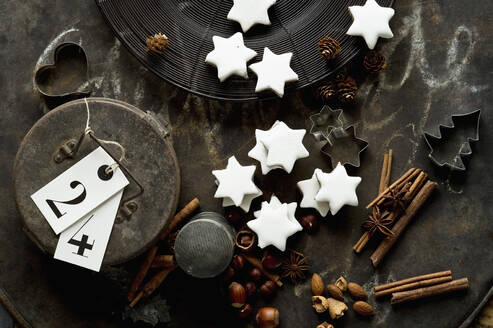 Rustic baking sheet, cinnamon sticks, star shaped Christmas cookies, cookie cutters, nuts and metal gift box - ASF06613
