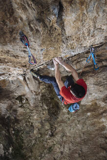 Aerial view of a climber on a hard sport climbing route in a cave - CAVF80825