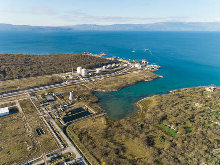 Aerial view of the construction of future LNG terminal on the shore of the bay in Omisalj, Croatia - AAEF08212