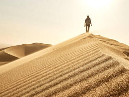 Woman on the ridge of a dune in the desert, Walvis Bay, Namibia - VEGF02067