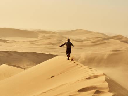 Man running on a dune in the desert, Dune 7, Walvis Bay, Namibia - VEGF02085