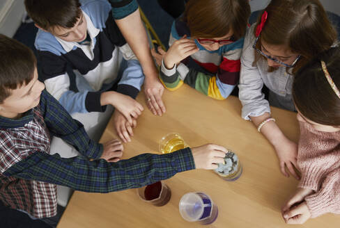 Group of children in a science chemistry lesson - PWF00066