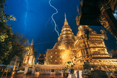 Lightning and thunderstorm over Wat Phra Singh Gold Temple at night, Chiang Mai, Thailand, Southeast Asia, Asia - RHPLF14626