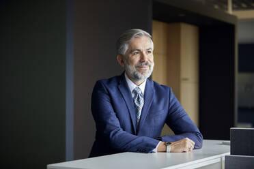 Portrait of confident mature businessman in office - RBF07658
