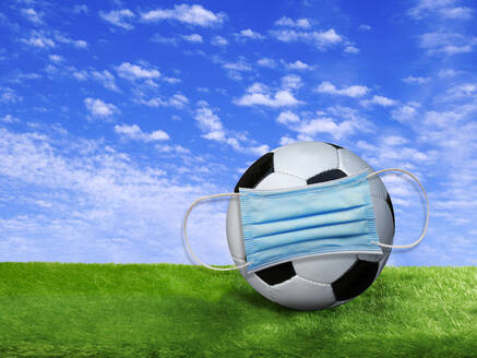 3D rendering, Soccer ball covered by surgigal mask on soccer field - BSCF00620