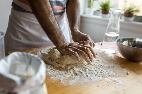 Crop view of man kneading dough - WPEF02881