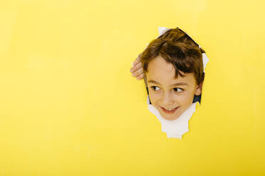 Yellow concept, children with different objects. Balloons, masks, blue squares, paint, banana - JRFF04445