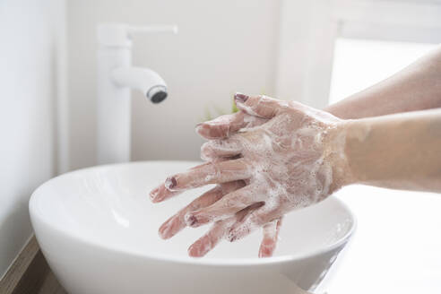 Close-up of woman washing her hand with soap - SNF00026